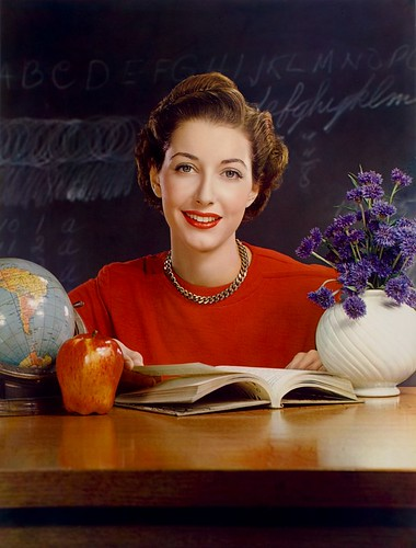 Timken Roller Bearing Co., calendar, September 1950, teacher at desk | by George Eastman House