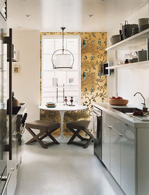 Ideas for small spaces: White galley kitchen + Saarinen table + X