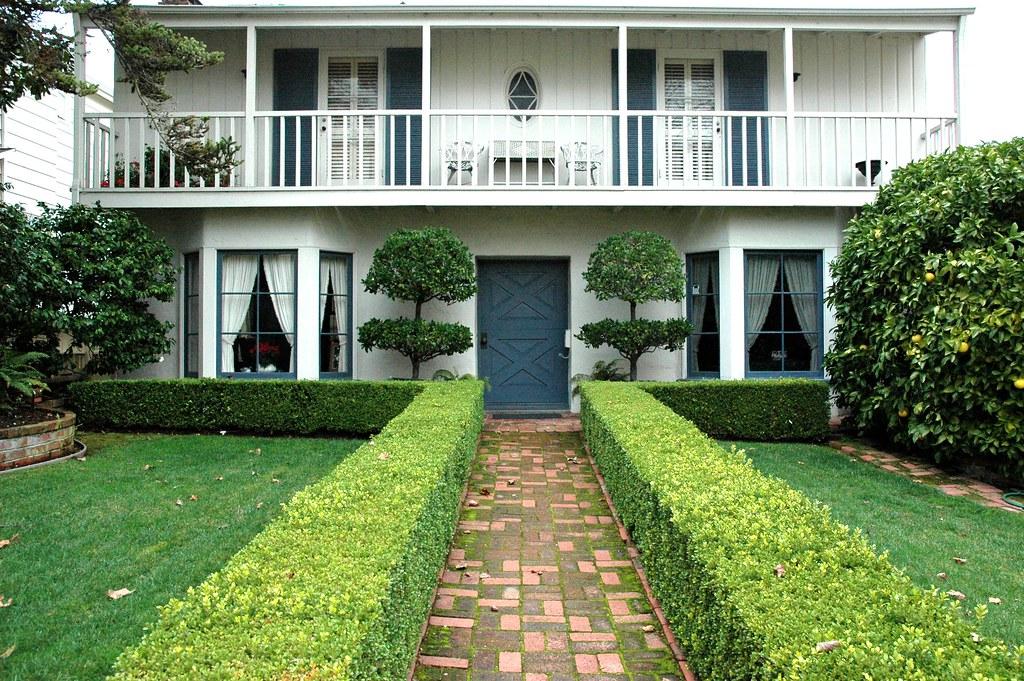 Green yard, white house, formal design, San Mateo house, S