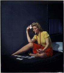 Woman in cell, playing solitaire | by George Eastman House
