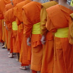 Line of monks moring alms Luang Prabang Laos