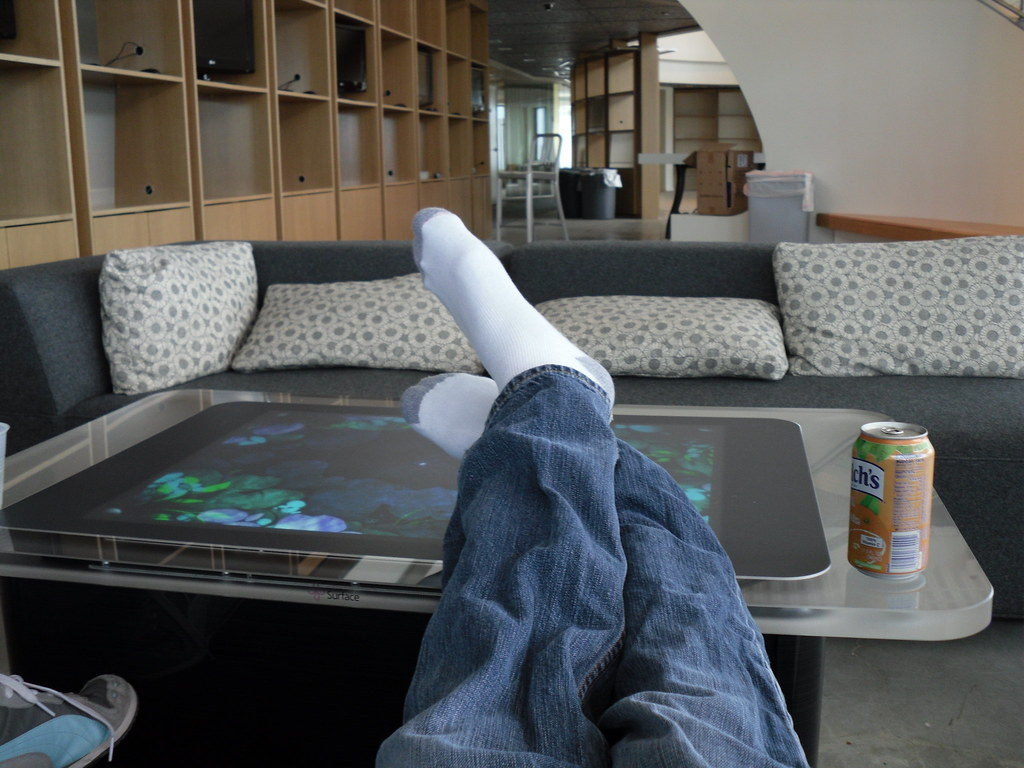 feet on a very expensive coffee table clint rutkas flickr. Black Bedroom Furniture Sets. Home Design Ideas