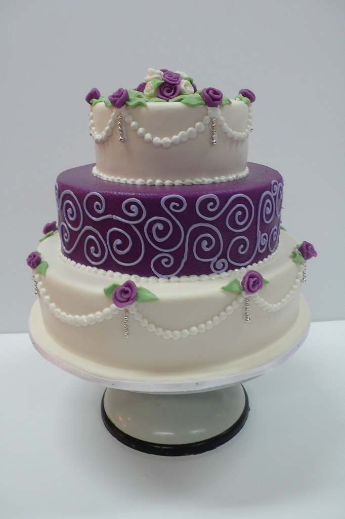 Classic purple and white wedding cake with marzipan roses ...