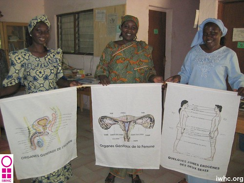 ALVF staff with reproductive health diagrams | by International Women's Health Coalition