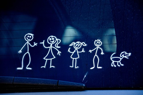The little family on the back window of a car | by Valerie Everett