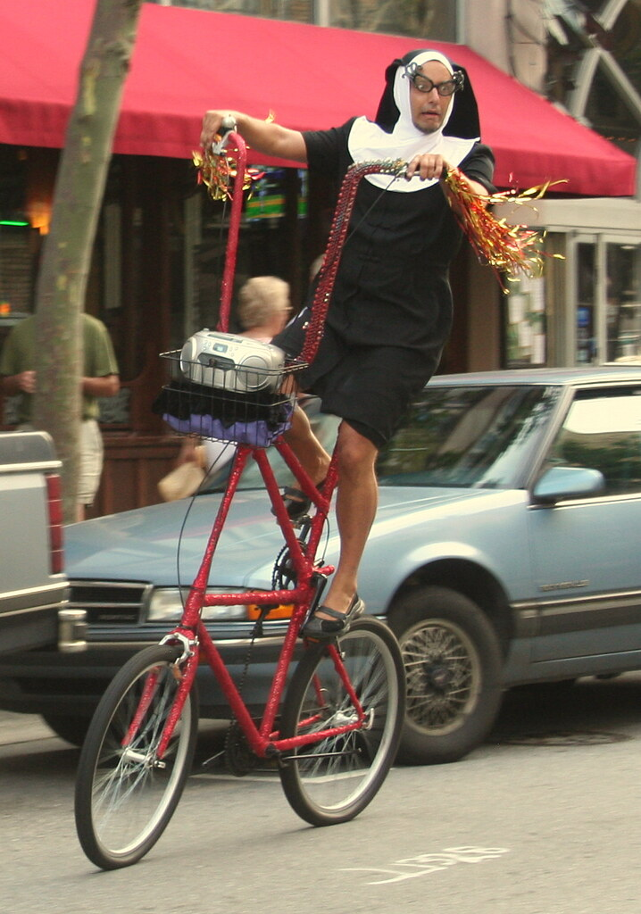 random cross dressing nun on a bicycle
