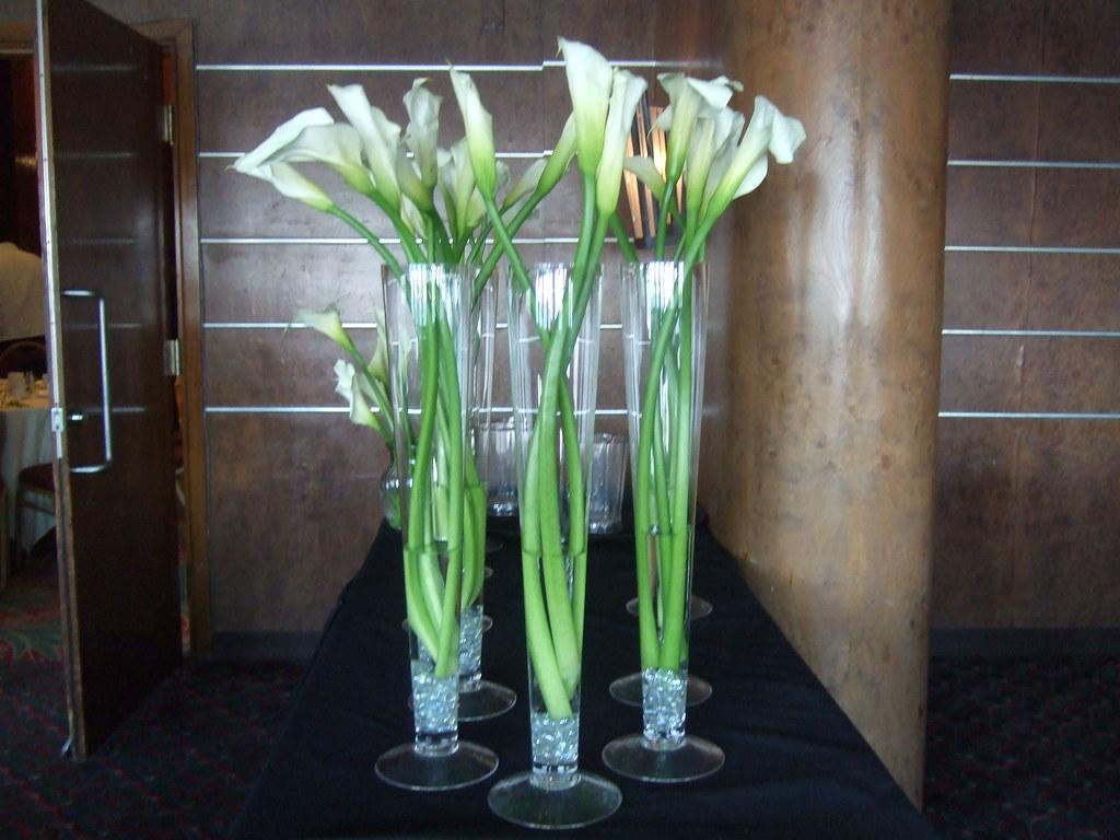 Centerpieces tall white calla lilies joy thornhill