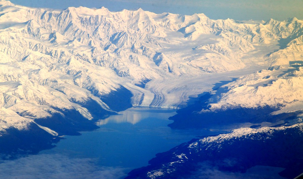 Snow covered peaks and glaciers in Prince William Sound, Alaska, by flickr user  Frank Kovalchek, licensed by Creative Commons