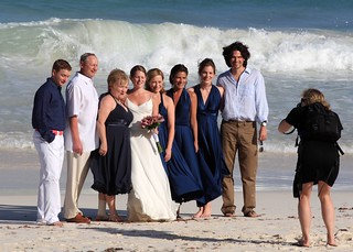 Wedding party on the beach in Tulum ready to be innudated by a large wave | by Alaskan Dude
