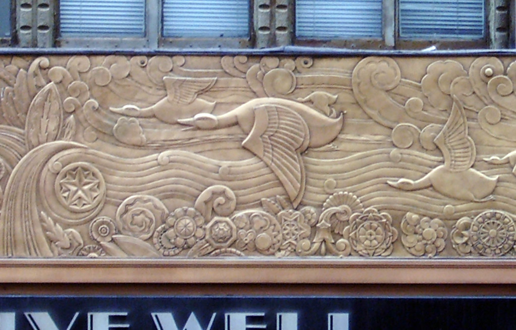Seabirds this metal mural wraps around a building on for Bas relief mural