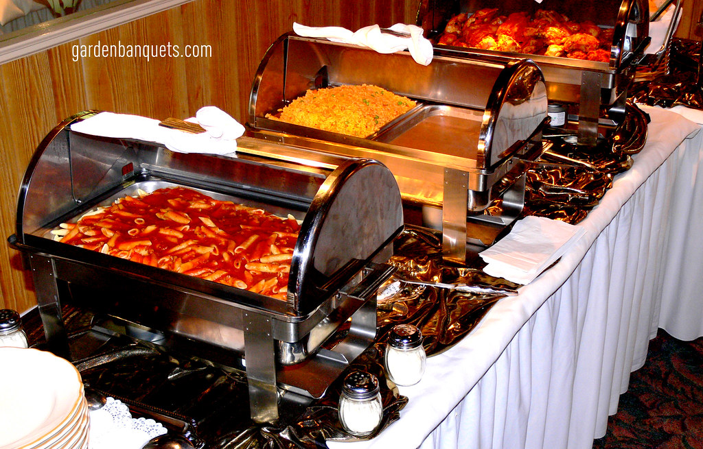Piping Hot Delicious Food On Elegant Quinceanera Buffet