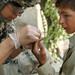 10th Mountain Medic treats Afghan boy