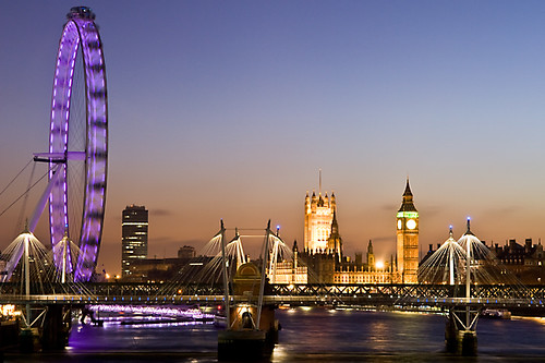 river thames at dusk with london eye and houses of parliam