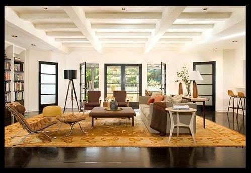 Open living room + neutral mix: Modern furniture + antique rug by Nickey Kehoe | by SarahKaron