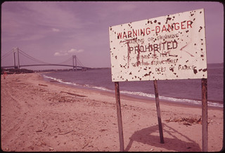 Warning of Polluted Water at Staten Island Beach Verrazano-Narrows Bridge in Background 06/1973 | by The U.S. National Archives