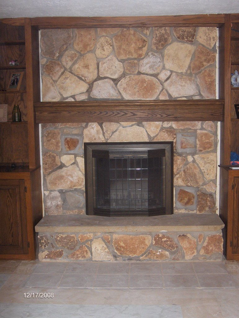 new mantle fireplace cover and tile in front of fireplac