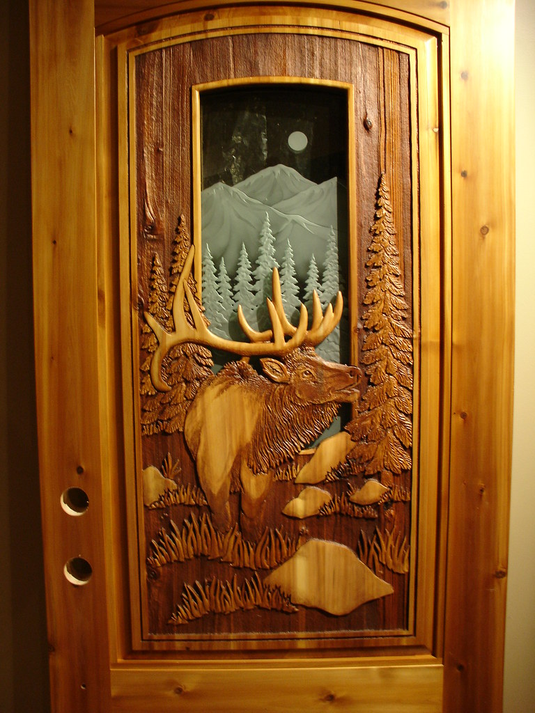 Carved elk door handcarved on sandcarved background
