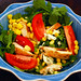 arugula salad with grilled chicken, corn, tomatoes and blue cheese