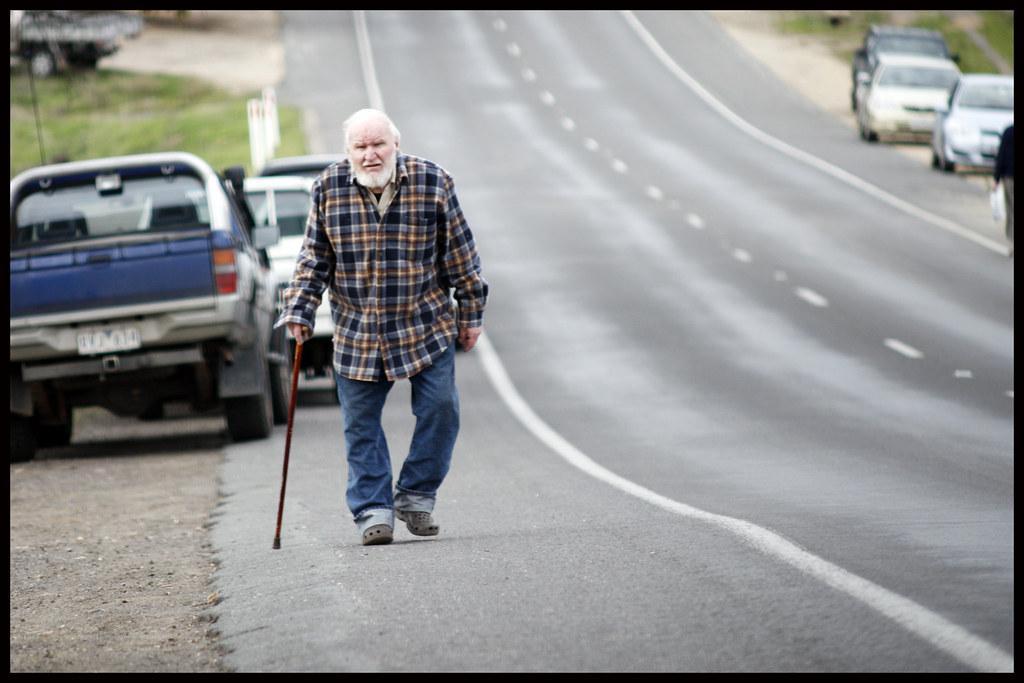Man Walking With Dog And Gun