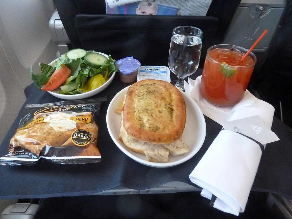 American airlines first class snack hot chicken and for American continental cuisine