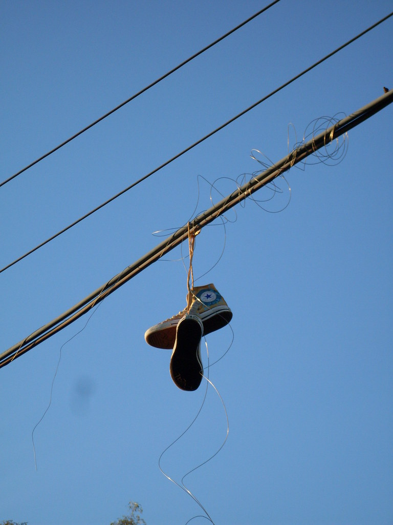 White Shoes Over Power Lines