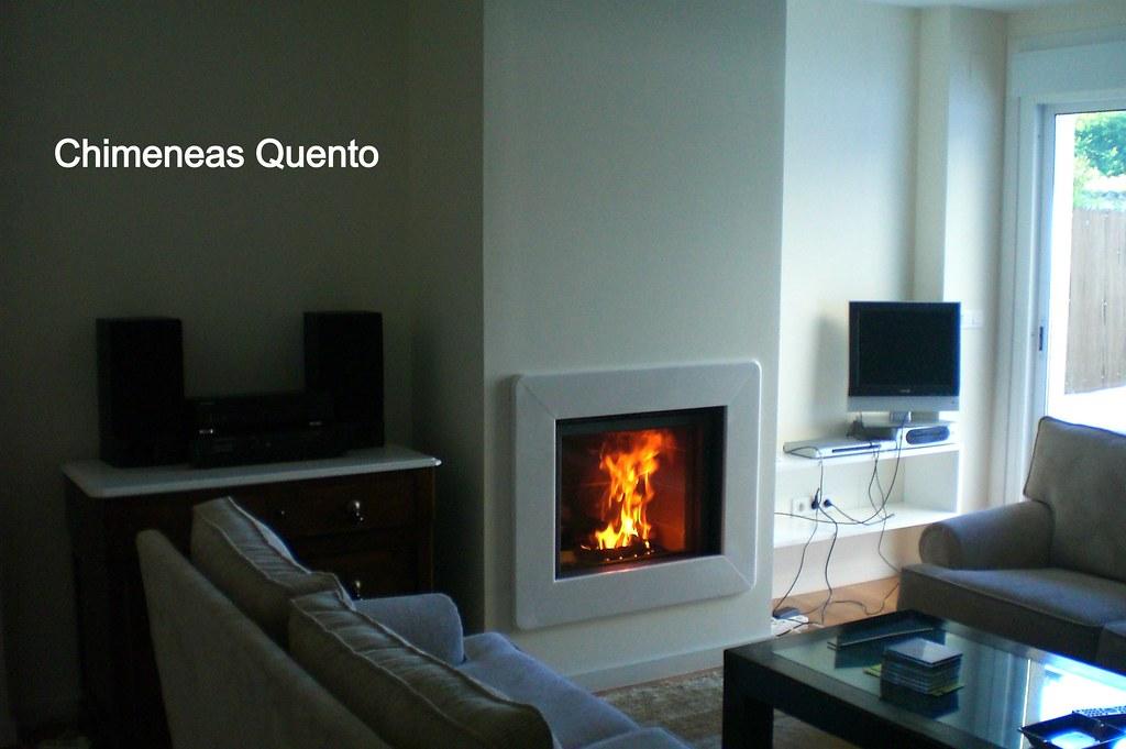 Chimenea quento stuv 65 con marco marmol blanco www - Marco de chimenea ...