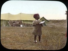 Small child in front of tents | by The Field Museum Library