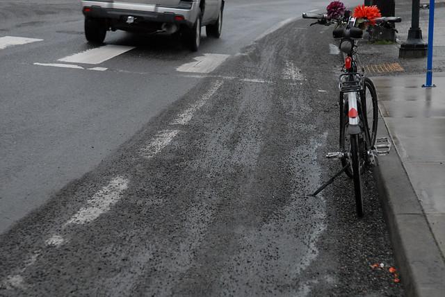 Gravel, leaves in bike lane-4