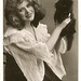 Miss Mabel Love with a fluffy black kitten.