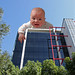 Giant Baby On Building Roof!