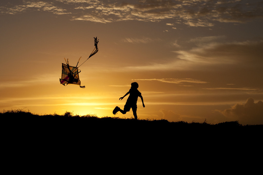 Kite kid A young boy charges about with crazy kid enthusia? Flickr