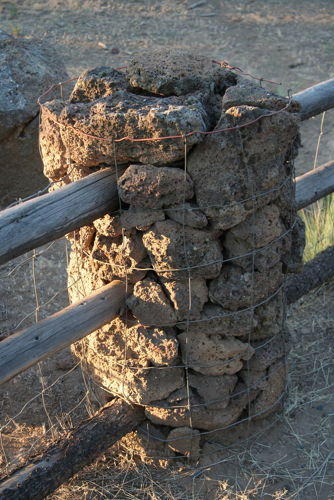 Lava Rock Fence Post Close Up A Close Up Of The Wire