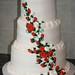 Wedding cake with red and white roses