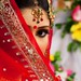 Bride covering eyes with veil