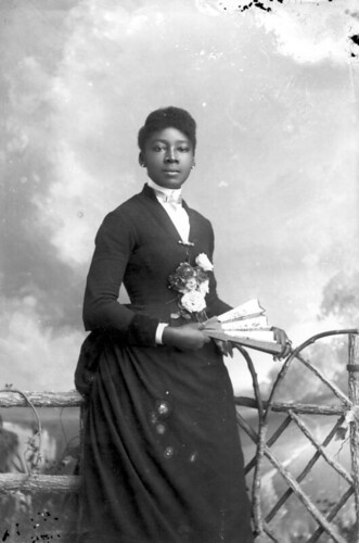 Woman in dark dress with roses on bodice | by State Library and Archives of Florida