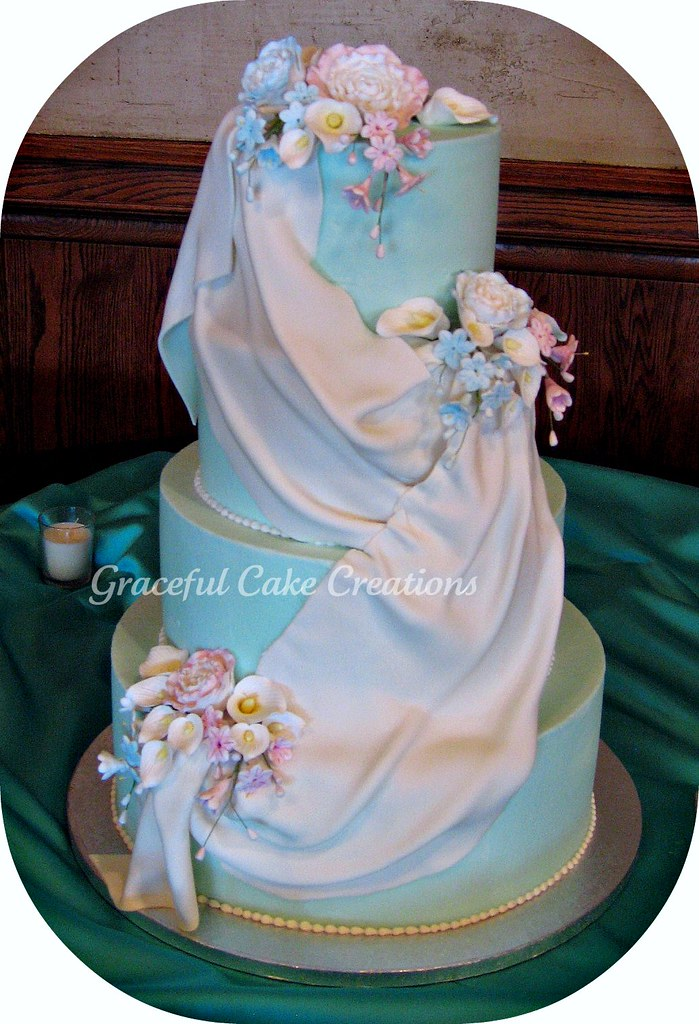 Turquoise Blue Wedding Cake With A French Drape Swag