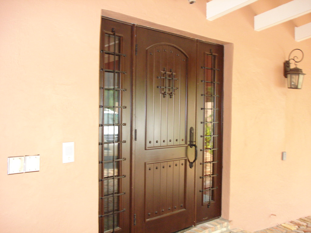 Mahogany front doors wrought iron speak easy grill with si for Single main door designs for home