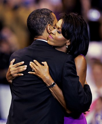 barack and michelle obama hugging at 2008 primary