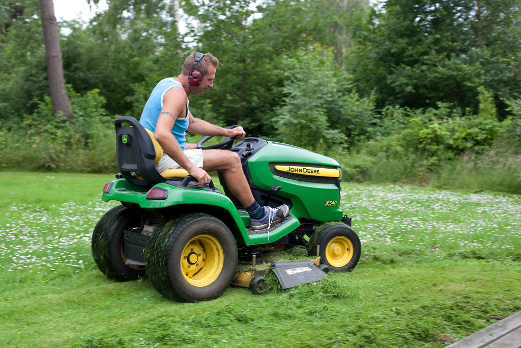 Man On Tractor Lawn Enforcment : Lawn mower man lucas was fascinated by the tractor and