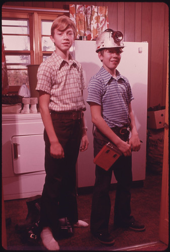 Michael, 14, and Darrell, 13, Are Sons of Wayne Gipson, a Miner and Minister Who Lives near Gruetli, Tennessee, near Chattanooga. Darrell Is Shown in Some of His Father's Mining Gear 12/1974 | by The U.S. National Archives