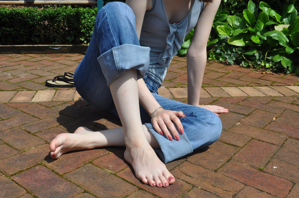 Pretty girl feet shoe dangle sole showing 2