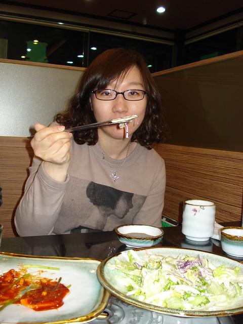 Cindy eats salad with chopsticks
