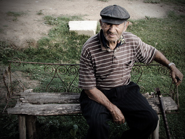Romanian Old Man An Amazing Old Man Sitting On A Bench