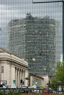 Reflections of Alpha Tower | by tim ellis
