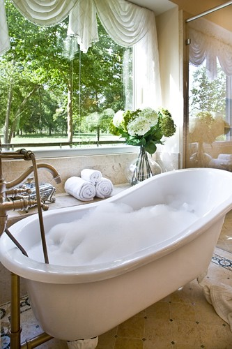 by design interiors stand alone bathtub by design. Black Bedroom Furniture Sets. Home Design Ideas