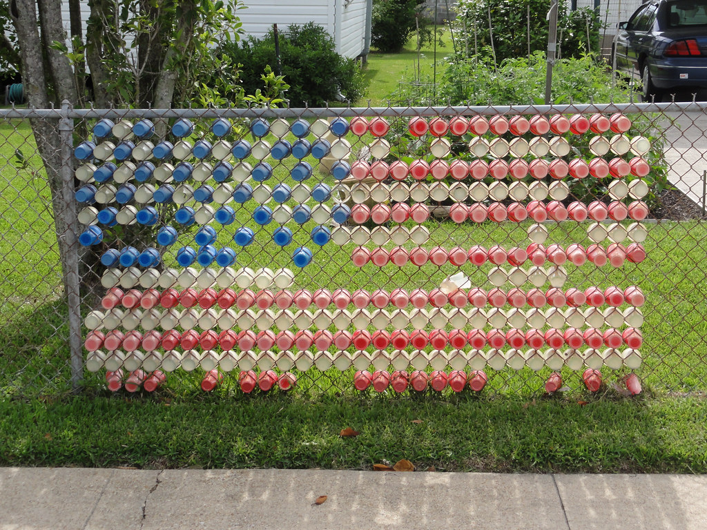 American Flag Quot A Chain Link Fence A Manicured Lawn The