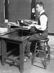 Engineering Department clerical worker at adding machine, 1915 | by Seattle Municipal Archives