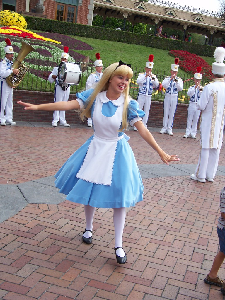 Alice dances to the music of the Disneyland Band at the Di ...