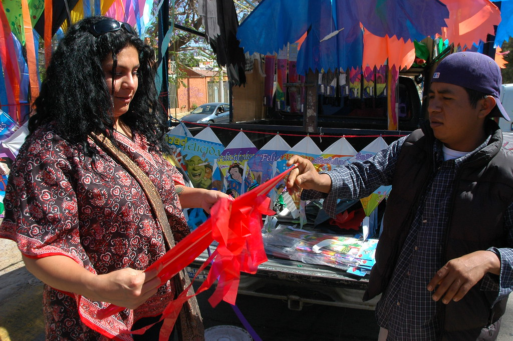 Rossy Buying A Red Kite From A Street Vendor Guadalajara