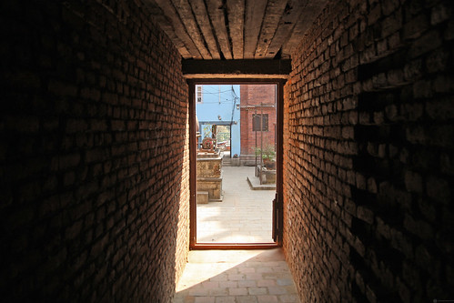 A doorway that leads to a courtyard in Kathmandu | by World Bank Photo Collection